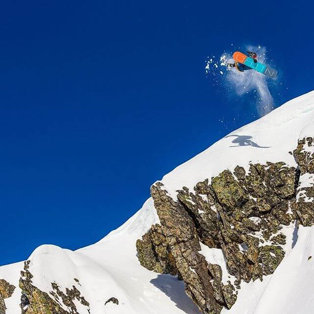 Soaring snowboarder
